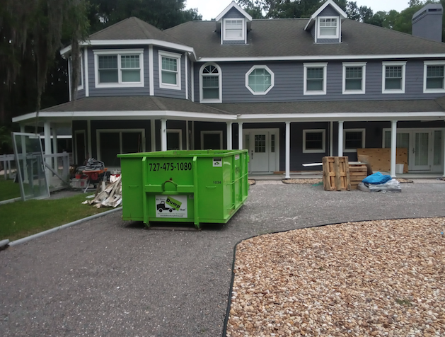 dumpsters on unpaved driveways